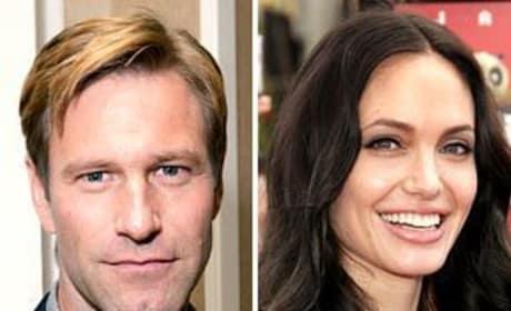 Aaron Eckhart Backs Angelina Jolie as Catwoman