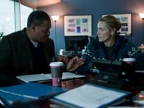 Kate Winslet and Laurence Fishburne in Contagion