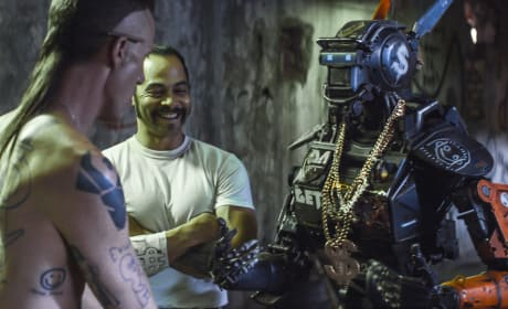 Chappie Releases 11 Photos: Hugh Jackman With a Mullet?!