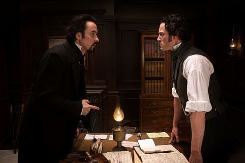 John Cusack and Luke Evans in The Raven