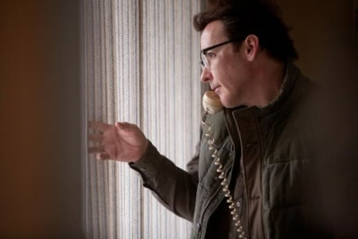Frozen Ground Still: Cusack Peeks out the Window
