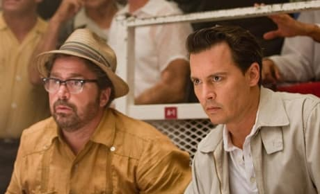 Michael Rispoli and Johnny Depp in The Rum Diary