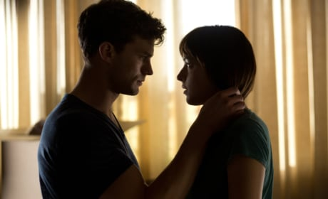 Fifty Shades of Grey Photos: What Is Jamie Dornan Doing to Dakota Johnson?