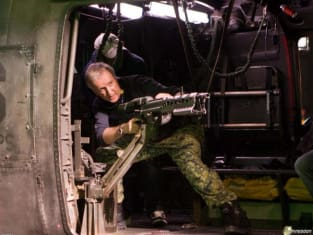 James Cameron playing soldier