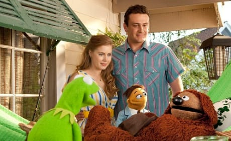 Kermit, Jason Segel and Amy Adams in The Muppets