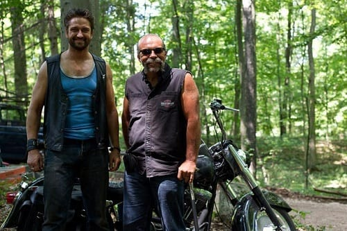 Gerard Butler and Sam Childers on Machine Gun Preacher Set