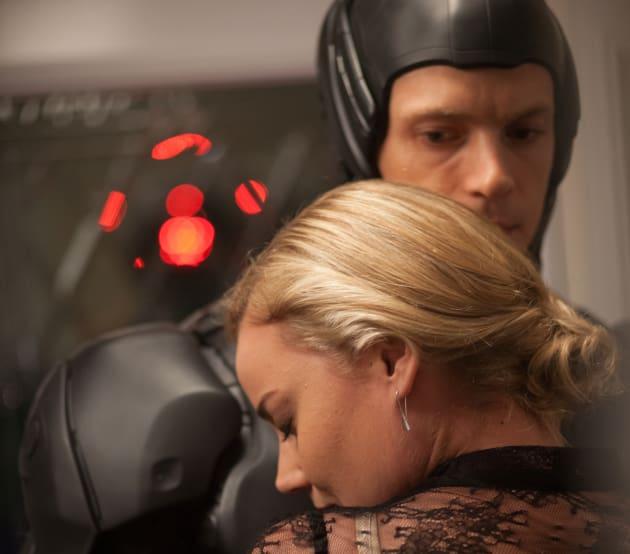 RoboCop Joel Kinnaman and Abbie Cornish