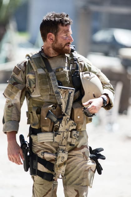 Bradley Cooper Talks a Heavily Armed Walk