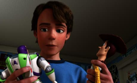 Andy Holds Woody and Buzz