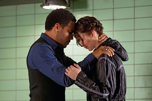 Lenny Kravitz and Jennifer Lawrence in The Hunger Games