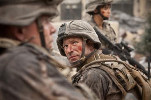 Aaron Echhart is Staff Sergeant Michael Nantz