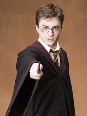Harry with wand in hand