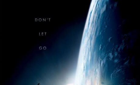 Gravity Poster: Sandra Bullock and George Clooney Stranded in Space