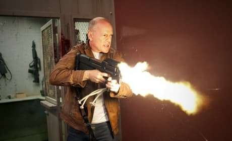 Looper Photos: Bruce Willis' Guns Blazing
