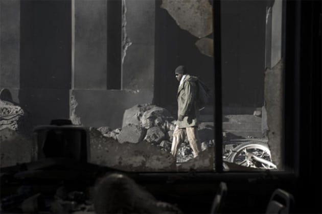Eli Walks Through the Ruins